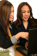 Women Business Team Discussing With Laptop 2