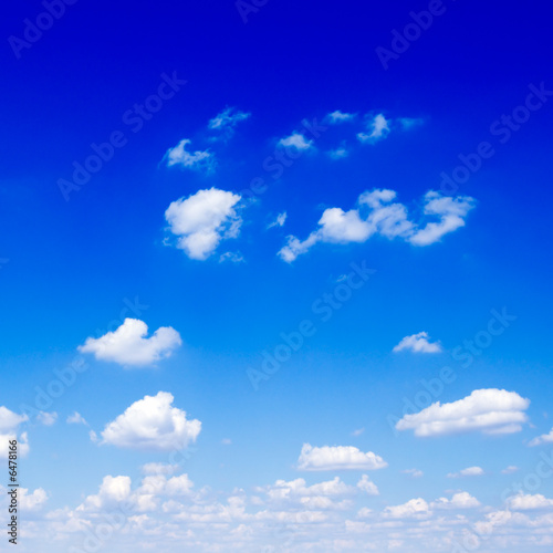 poster of Beautiful white fluffy clouds in the blue sky.