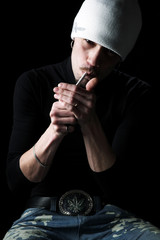 Smoking the man on a black background