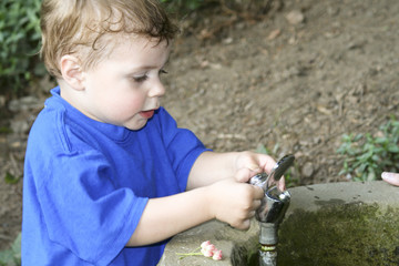 Toddler and water fountain