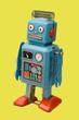 retro robot toy yellow background