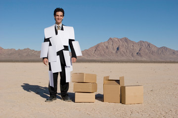 Businessman covered with white papers