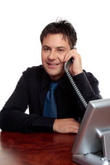 Businessman, salesman or consultant on telephone call.