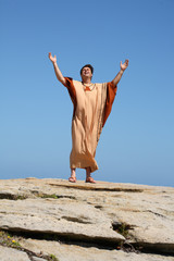 Man with arms raised to the sky in worship