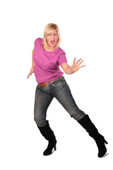 middleaged woman in pink shirt stands dancing 4