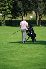 Senior woman by golf