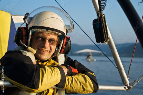 Smiling pilot of mootorized hang-glider. - 6501531