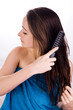 Woman is grooming her hair
