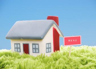 Model of house on blue sky background