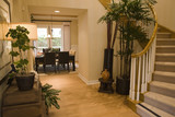 Spacious hardwood floor hallway. poster