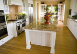 Modern Kitchen with a hardwood floor. poster