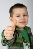 Thumb up ! Eight years old caucasian boy.