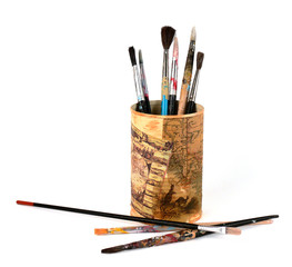 Watercolor brushes in tin can