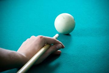 The guy plays billiards