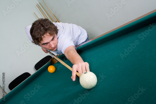 The guy plays billiards
