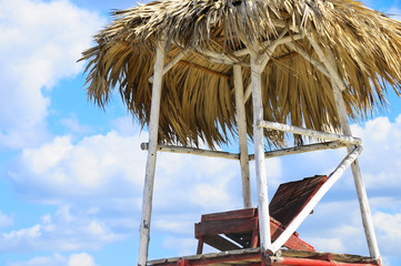 Detail of tropical beach chair against summer sky