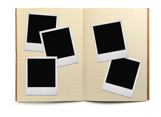 lined exercise book and photo frames