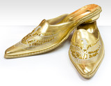 Gold shoes in the Arabian style poster