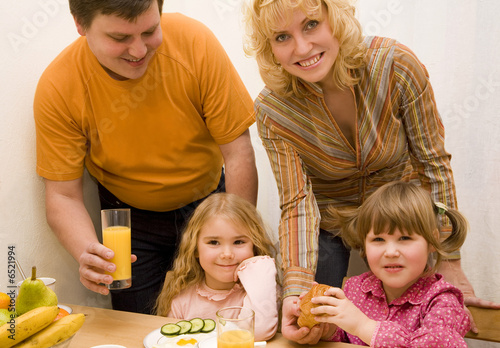 Young family have a breakfast at the table