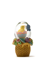Easter chick in glass egg