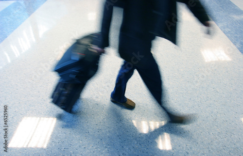 Man rushing in ariport to catch his flight
