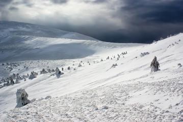 mountain peak lanscape against snow storm