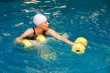 Girl in water with dumbbels