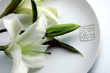 Chinese pottery plate and white lily, China poster
