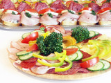 Cold food - salami and fresh vegetables served on plate poster