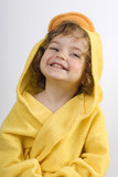 laughing girl after bath in yellow towel poster