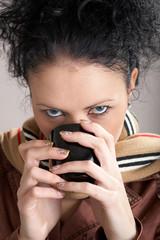 Girl drinking hot tea