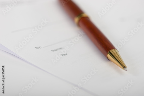 an expensive red pen on a contract