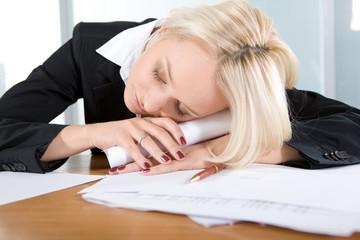 Young  beautiful business woman sleeping
