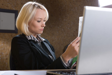 Young  beautiful business woman reading4