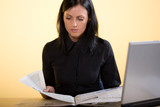 Young  beautiful business woman reading3