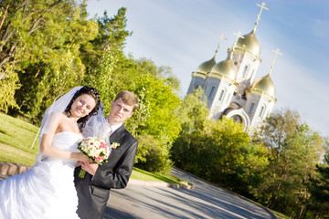 a bride and a groom near the church
