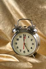 Metallic old-fashioned alarm-clock