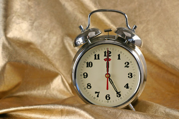 Metallic old-fashioned alarm-clock