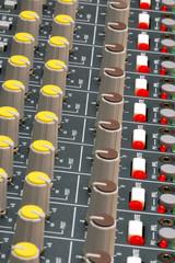 soundboard mixer dials and lights