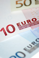 Euro banknotes close-up on white background