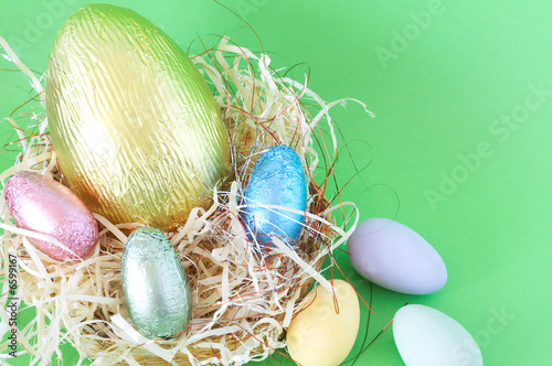 Chocolate Easter eggs in straw