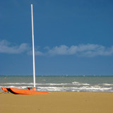Upper Adriatic Beach with high and dry sailboat poster