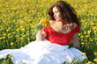 Girl in dandelion field