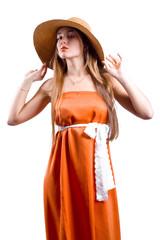 Woman in hat in long dress