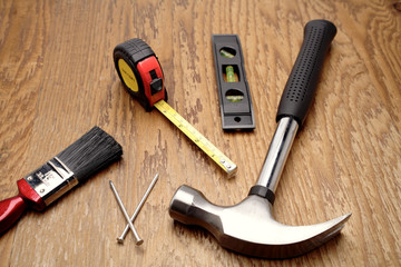 Assorted tools on wood panel