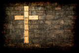 cross of christ built into a brick wall poster