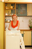 Woman with her new dishwashing machine poster