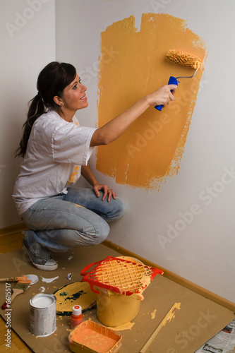 Woman colours her first flat