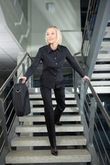 pretty businesswoman in a rush