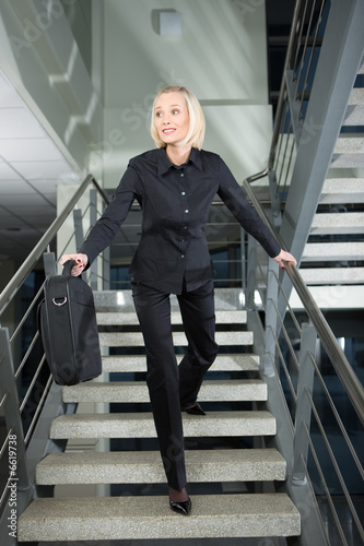 pretty businesswoman in a rush